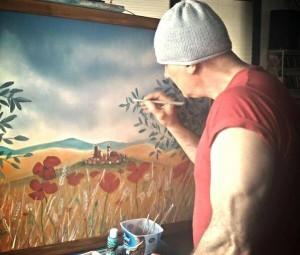 Antonio Saputo mentre dipinge