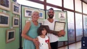Il vincitore del concorso con l'assessore Colzi