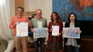 nella foto da sinistra: Paolo Fissi, vice-preside, il sindaco Lorenzini, Valentina Elena Ballerini e l'assessore alla pubblica istruzione De Masi con alcuni dei fumetti prodotti dai bambini